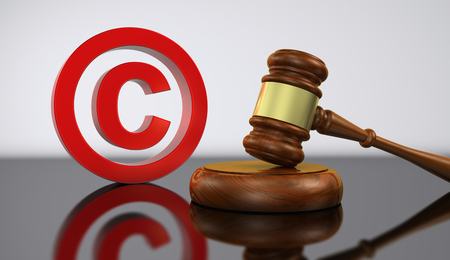 Copyright laws and intellectual property concept 3D illustration with red copyright symbol icon and a wooden gavel.
