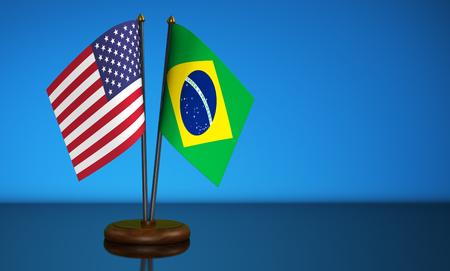 USA flag and Brazil desk flags commerce, friendship and trading relations concept 3D illustration. Stock Photo