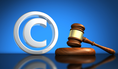 Copyright laws and intellectual property concept 3D illustration with silver copyright symbol icon and a wooden gavel on blue background.