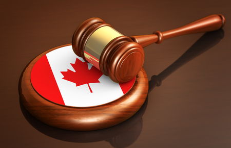 Canadian law, lawsuit and justice concept with a 3d rendering of a judge gavel and the flag of Canada on a wooden desk.