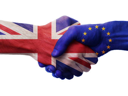 UK and European Union bilateral political relations and cooperation concept with Union Jack flag and EU flag painted on handshake. Stok Fotoğraf