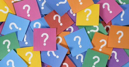 Question mark symbol and sign on many colorful note papers, customer questions and business faq assistance concept top view background.