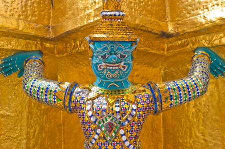 The giant statue supporting golden pagoda on Grand Palace in Phra Kaew Temple, Bangkok Thailand, Public domain  photo