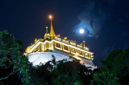 The full moon at Golden Mountain and Wat Saket in Thailand  photo