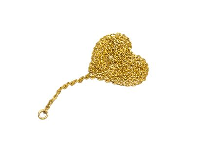 Gold chain with a heart-shaped arrangement  Isolated on a white background  photo