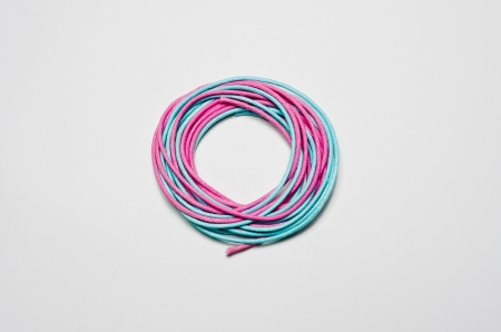 The pink and blue yarn spinning is spherical. Isolated on a white background. photo