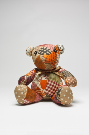 Teddy bears made ​​from fabric scraps. Isolated on white.