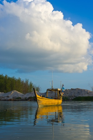 Fishing boat for yellow fish at the The beach. Under a beautiful blue sky.