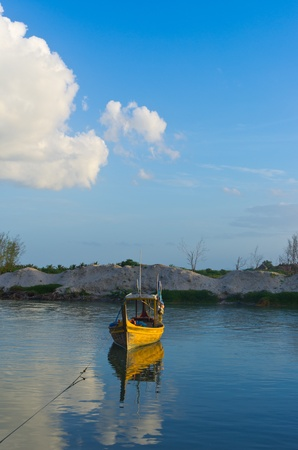 Fishing boat for yellow fish at the The beach. Under a beautiful blue sky. photo