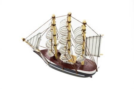 Model Barque with full sails up Isolated on white.