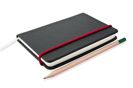 Small black notebook with blank cover. Isolated on white. Stock Photo