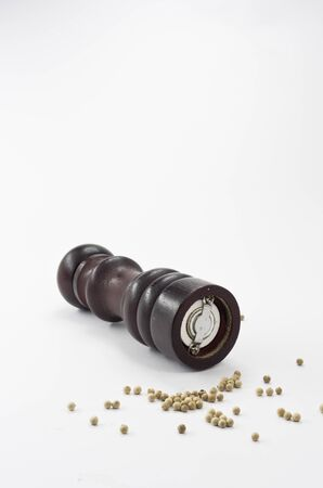 A Wooden pepper grinder isolated on white background Stock Photo
