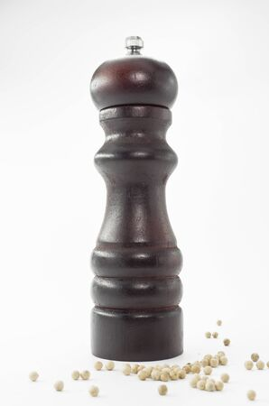 A Wooden pepper grinder isolated on white background photo