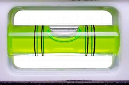 Green bubble level isolated on a white background