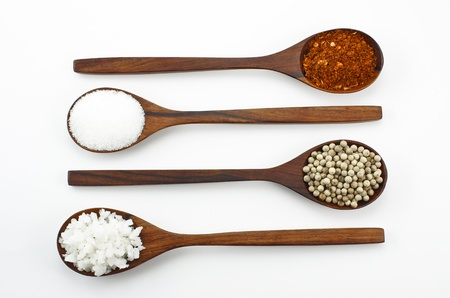 Cayenne pepper, salt and sugar. Arranged in a wooden spoon. Stock Photo