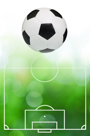 Classic soccer ball with green bokeh abstract light background photo