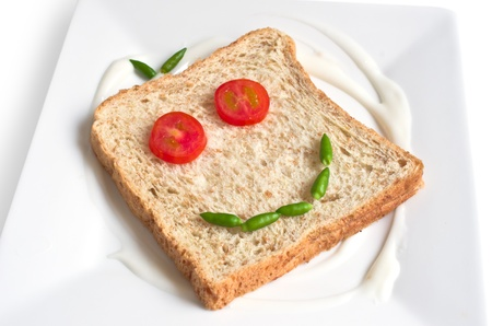 Bread wheat straw as a smiley face  With tomatoes and green chilies  photo