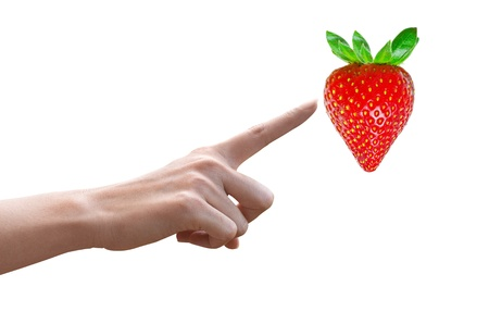 Woman hand pointing to a Red strawberry, Concept selection Stock Photo - 15960083