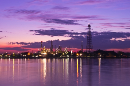 automobile industry: Oil refinery factory at Twilight. Chao Phraya river in Bangkok, Thailand. Stock Photo