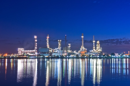Oil refinery factory at Twilight. Chao Phraya river in Bangkok, Thailand. photo
