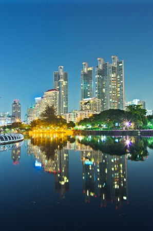 Bangkok cityscape at twilight with reflection of skyline ,Thailand. photo