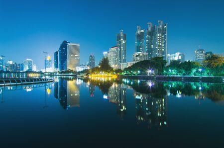 Bangkok cityscape at twilight with reflection of skyline ,Thailand. photo