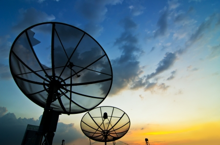 At twilight Satellite dish antenna communication Technology Network Stock Photo