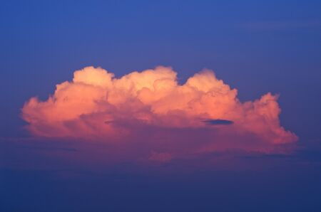 Golden clouds on a blue sky at sunset. photo