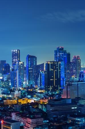 Landscape Bangkok city Modern building at twilight, high angle. photo