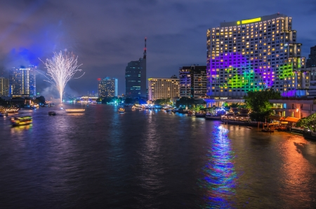 Landscape Bangkok city Modern building at twilight with Firework photo