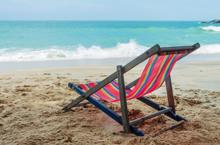 Wooden chairs and colorful canvas. Sea View in Thailand. Stock Photo - 17214067