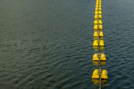 Yellow buoys mark the entrance to the dam photo