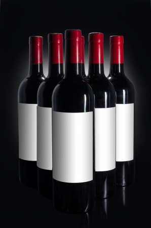 Bottle of red wine on the black background. photo