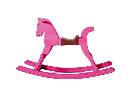 Child's wooden rocking horse, pink isolated on white background. photo