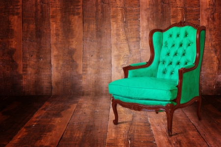 Luxury green sofa in the background of the wood. Stock Photo