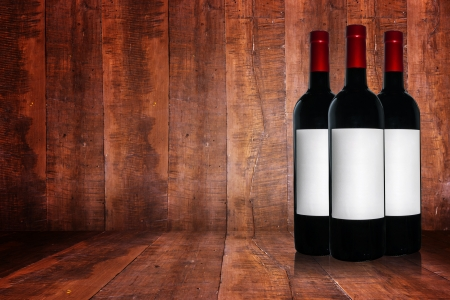 Bottle of red wine on a wooden background. photo
