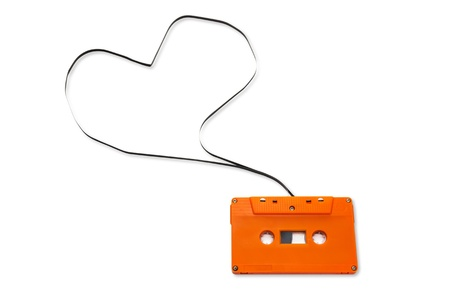 Orange Vintage audio cassette with speech bubbles  isolated on white background. photo