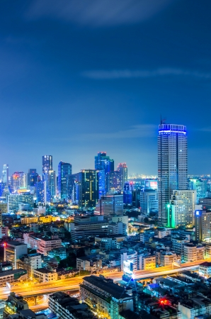 Landscape Bangkok city Modern building at twilight, high angle. photo