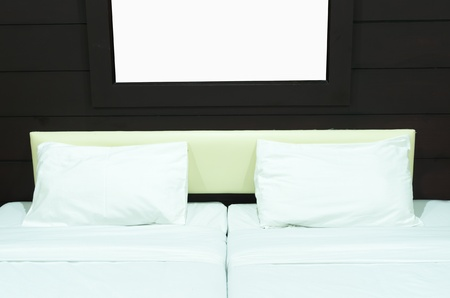 Double bed in a room with warm light.