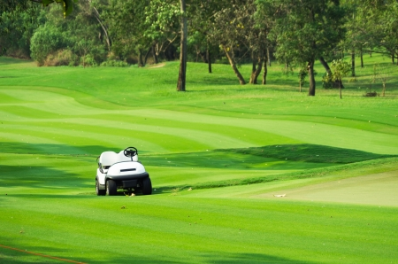 Golf course with golf car on fairway photo