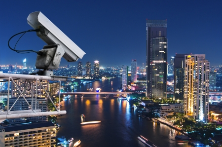 electronic survey: Security camera detects the movement of traffic. Skyscraper rooftop.