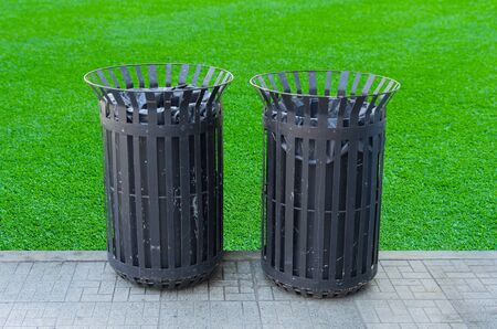 aisles: Black bins outside the steel structure. The side aisles. Stock Photo