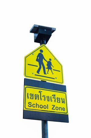 School zone sign isolated on white. Use of solar energy. photo