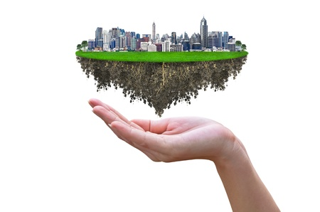 elysium: Cityscape, modern building on a white background  with woman hand and tree, concept ECO. Stock Photo