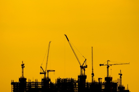 Silhouette crane construction industry and building work. photo
