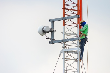 Employees are installing an antenna for transmission. 写真素材