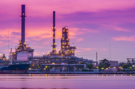 Oil and gas refinery at twilight - Petrochemical factory Stock Photo