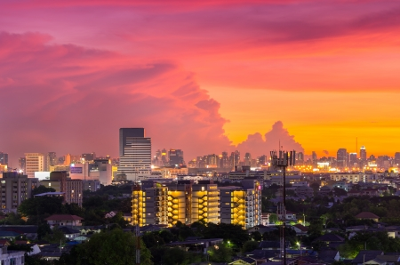 Beautiful Cityscape view of Bangkoks business district and a residential neighborhood at dusk. photo