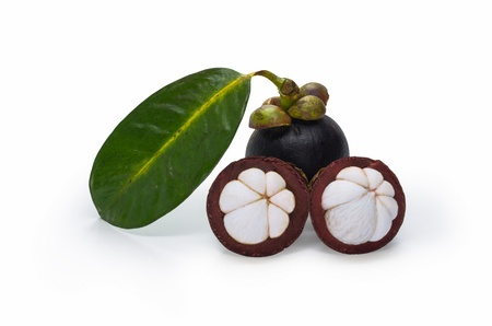 Mangosteen and cross section showing the thick purple skin and white flesh of the queen of friuts.