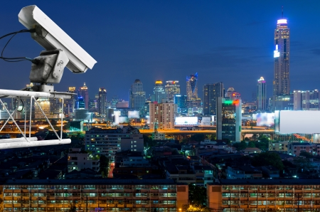 Security camera detects the movement of traffic. Skyscraper rooftop. photo
